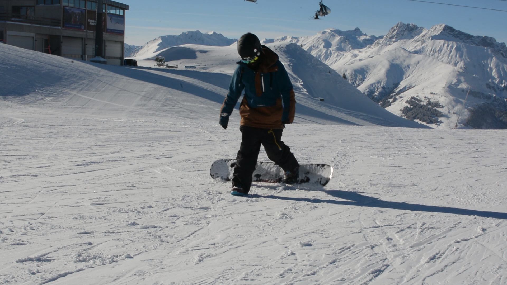 climbing on a snowboard